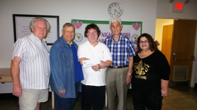 Gay Easter Parade and Food for Friends - $1,000 Sponsorship Grant FNBMG's Sam Stewart, Gay Easter Parade's Rip Naquin and Marsha Delain, FNBMG's Larry Anderson and Suzanne May