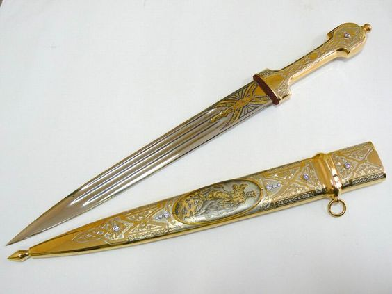 The hilt features pearl studs and macguffin inlay.