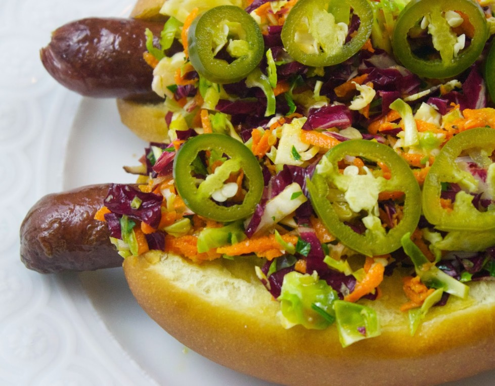 FOXHOLLOW HOT DOGS W/ BRUSSEL SPROUTS, CANDIED ONIONS & PICKELED JALAPENO