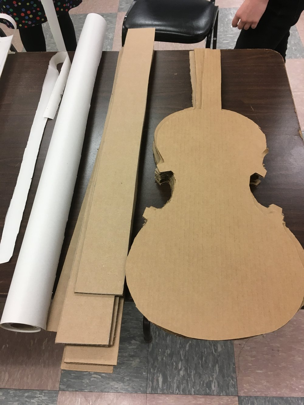 Cardboard awaiting transformation.JPG