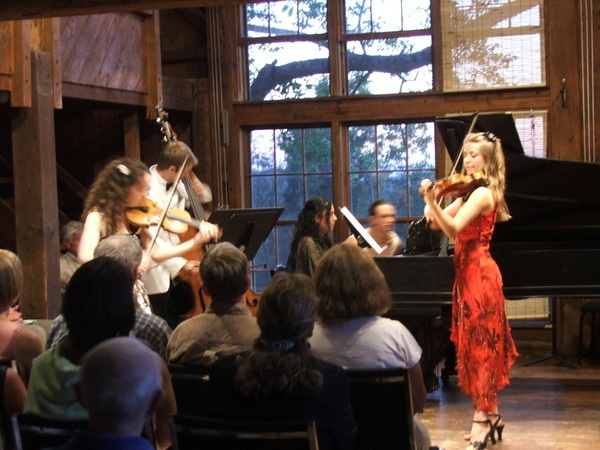 A 2006 performance of Bach's Concerto for Two Violins when Ealain performed alongside her teacher Elise (Apple Hill Hill String Quartet violinist)