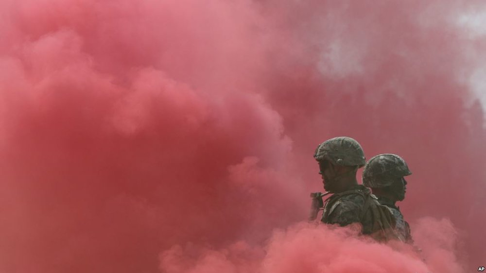 FILE - South Korea and U.S. Marines stand in smoke during the 66th Incheon Landing Operations Commemoration ceremony in Incheon, South Korea, Sept. 9, 2016.