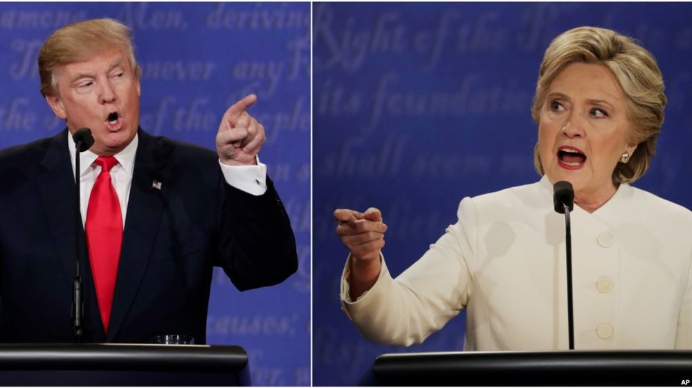 FILE - Republican presidential nominee Donald Trump and Democratic presidential nominee Hillary Clinton speak during the third presidential debate at UNLV in Las Vegas, Oct. 19, 2016.