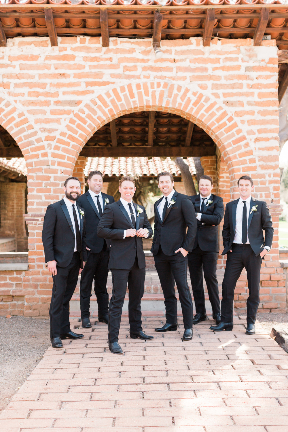 Groomsmen and groom in black tuxedos at Tubac Golf Resort