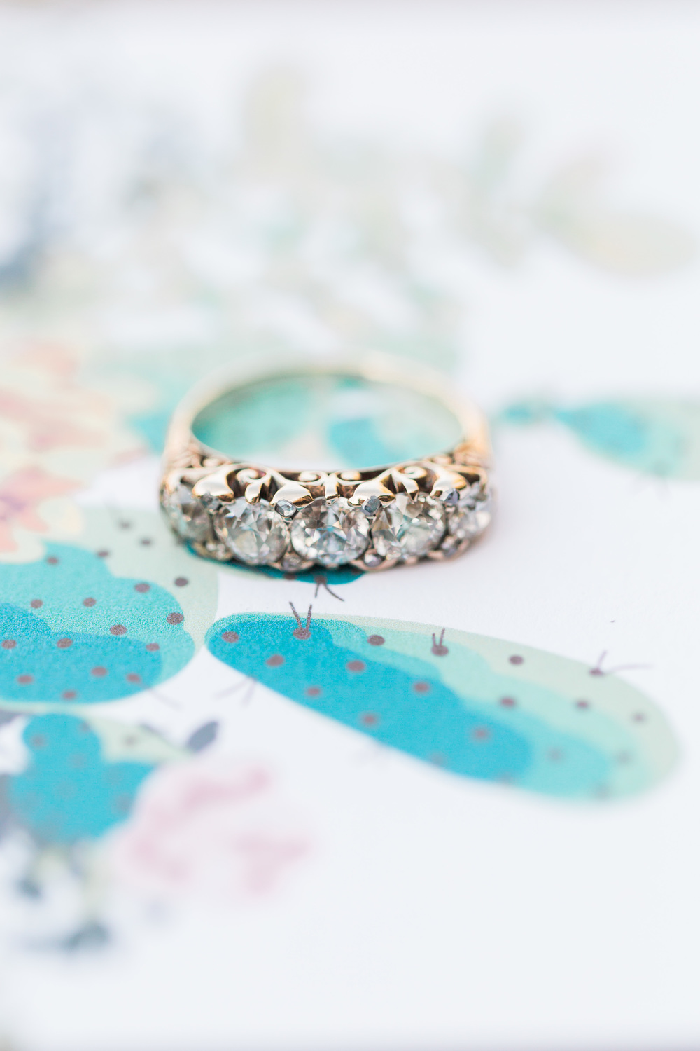 Gorgeous antique ring on cactus wedding invitations