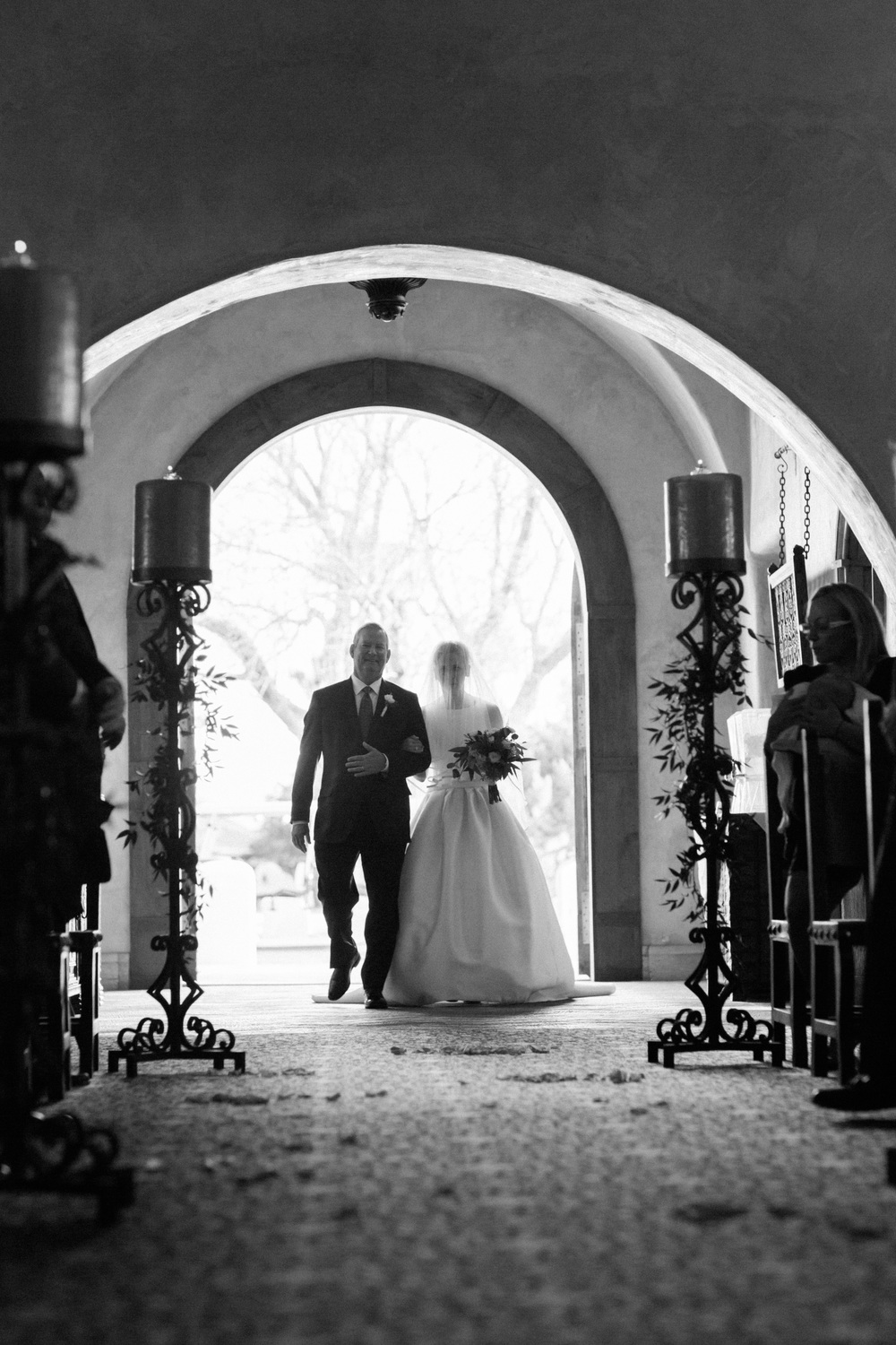 Father walking the bride through the chapel doors at Tubac Golf Resort
