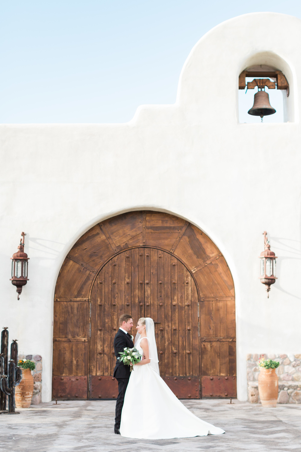 Bride and Groom in front of gorgeous chaple at Tubac Golf Resort by Tubac Wedding Photographers Betsy & John