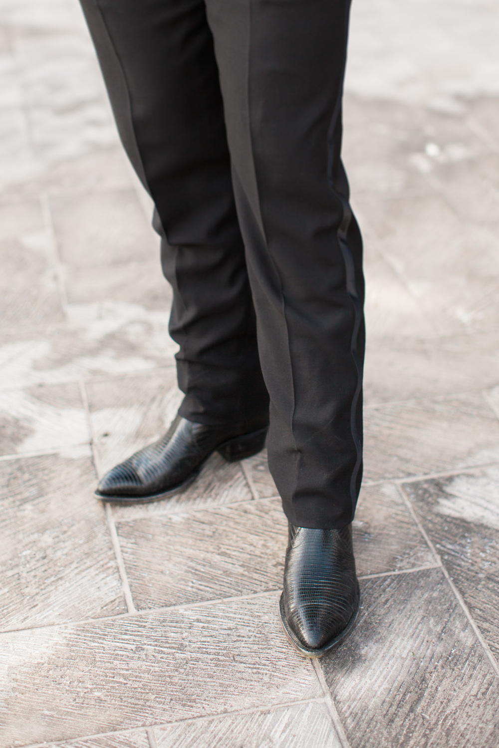 Groom wearing black cowboy boots