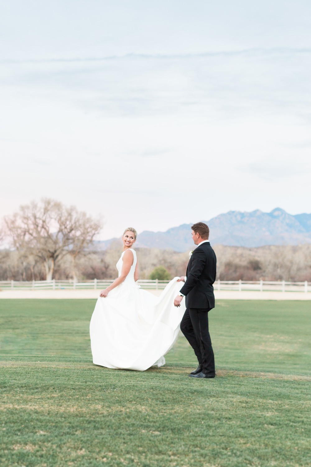 Bride smiling at Groom on golf course at Tubac Golf Resort
