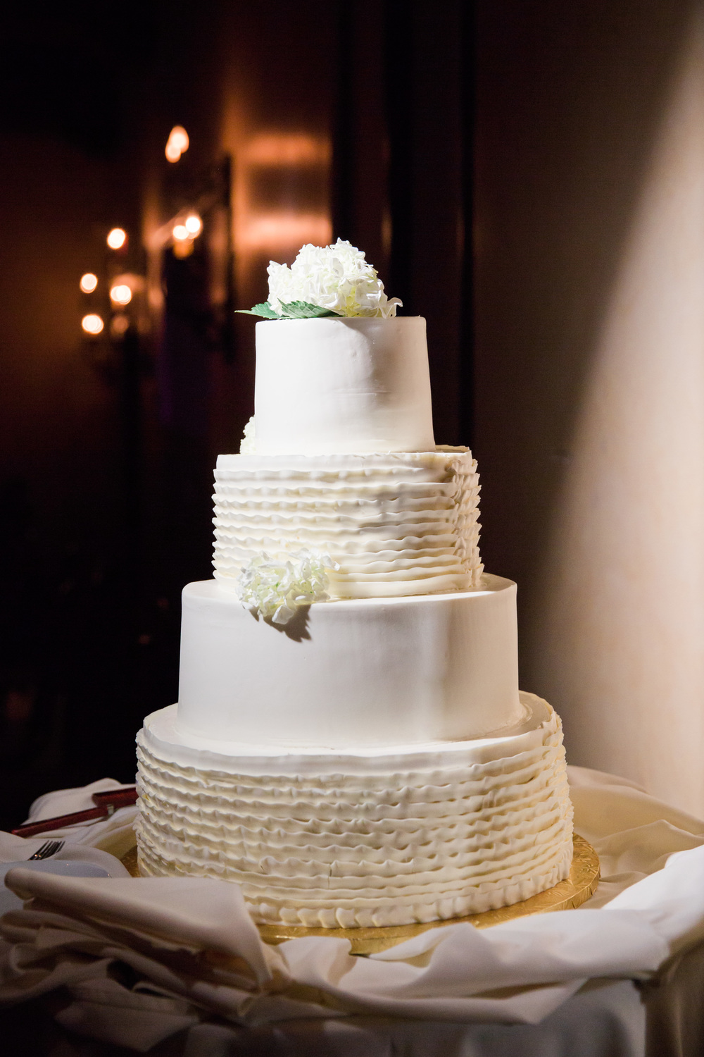 Gorgeous white wedding cake with ruffles by Village Bakehouse in Tucson