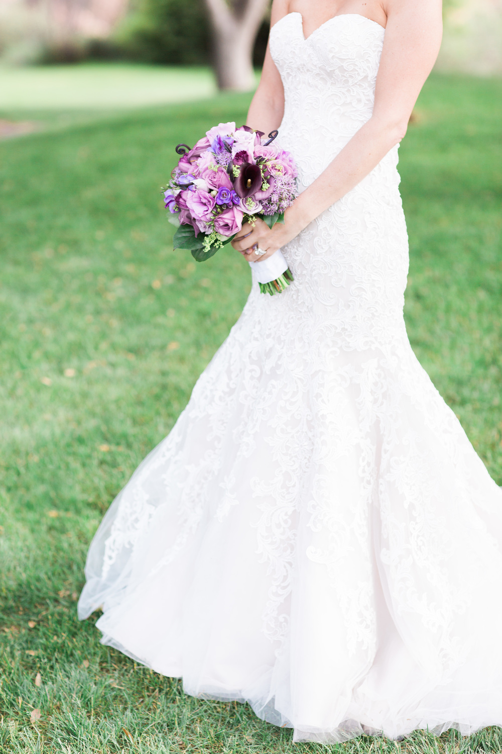 Purple bride's bouquet with gorgeous lace dress | Van Dickson Ranch Wedding | Prescott Wedding Photographers | See more at BetsyandJohn.com