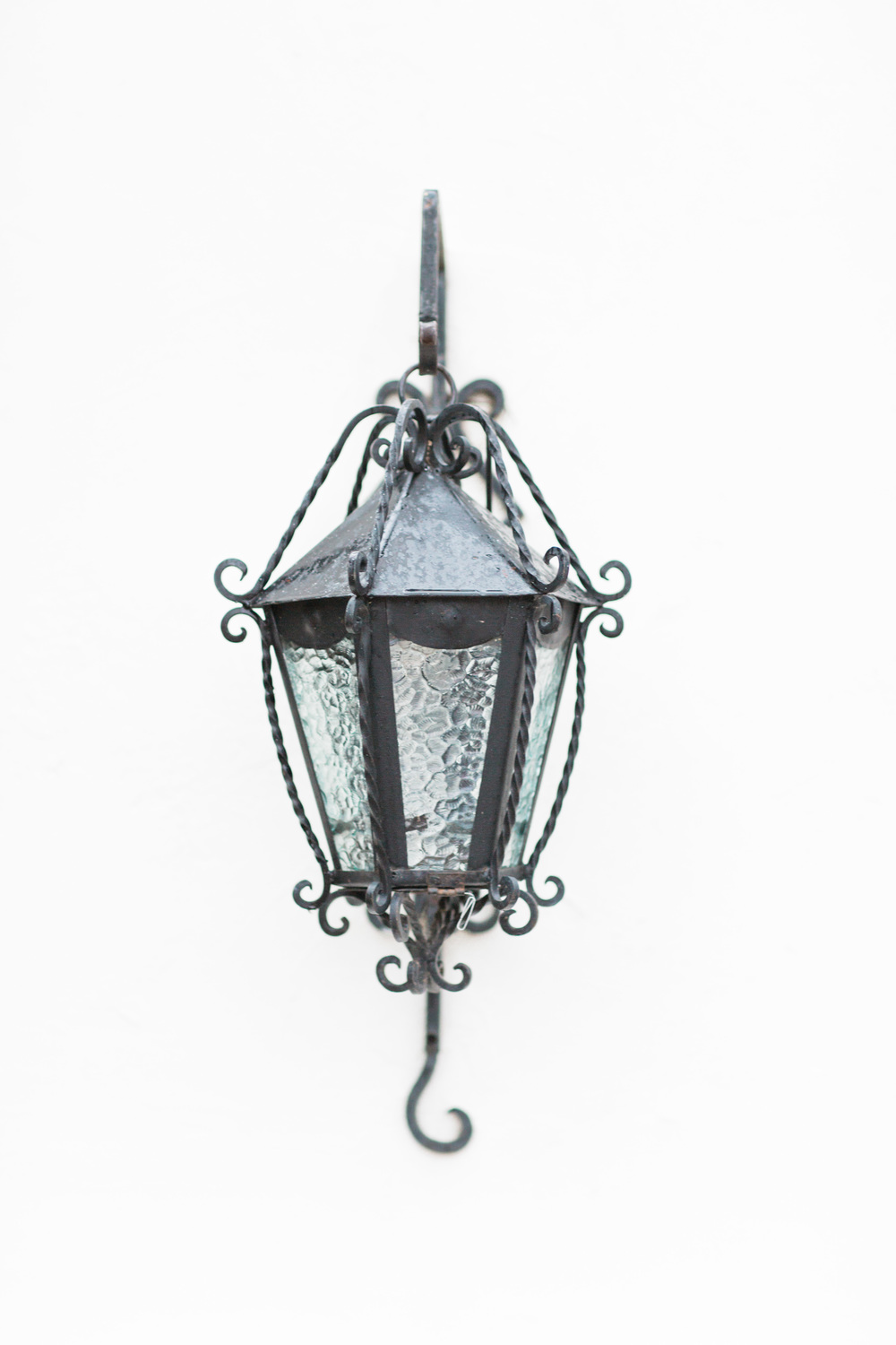 Ornate lantern on white wall at Tubac Golf Resort