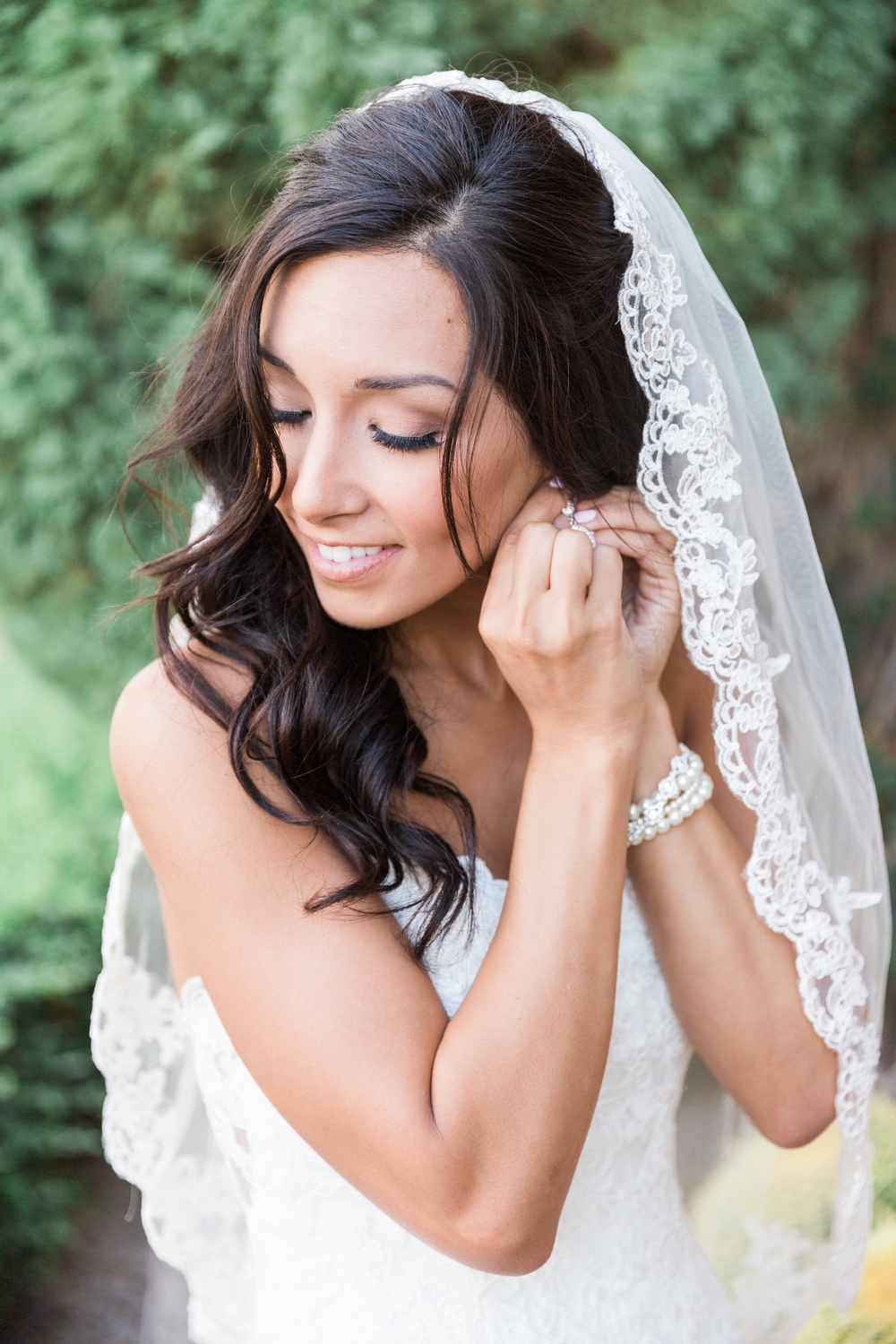 Gorgeous Bride puts on her jewelry | Superstition Mountain Golf Club Wedding | Phoenix Wedding Photographers | See more at BetsyandJohn.com