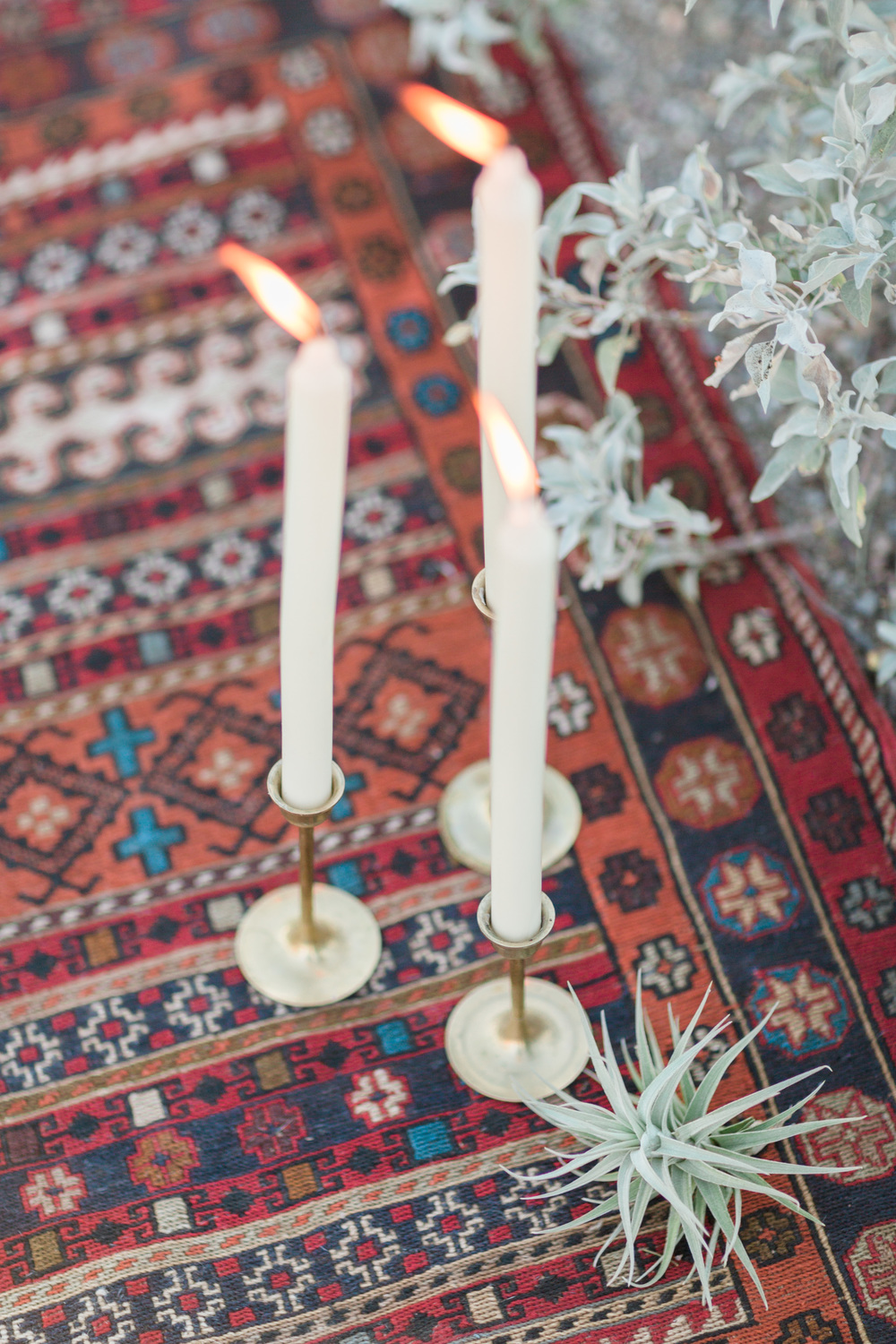 Candles and air plants on a gorgeous Turkish kilim rug