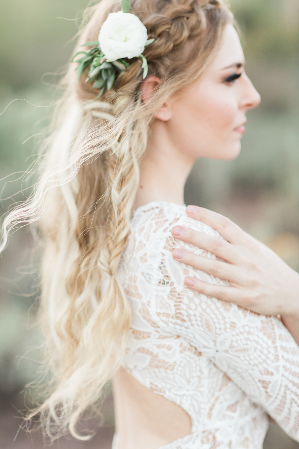 Boho bride with a braid and a gorgeous white floral clip in her hair
