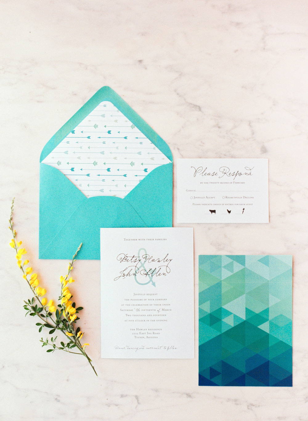 Teal wedding invitations designed by Betsy and John