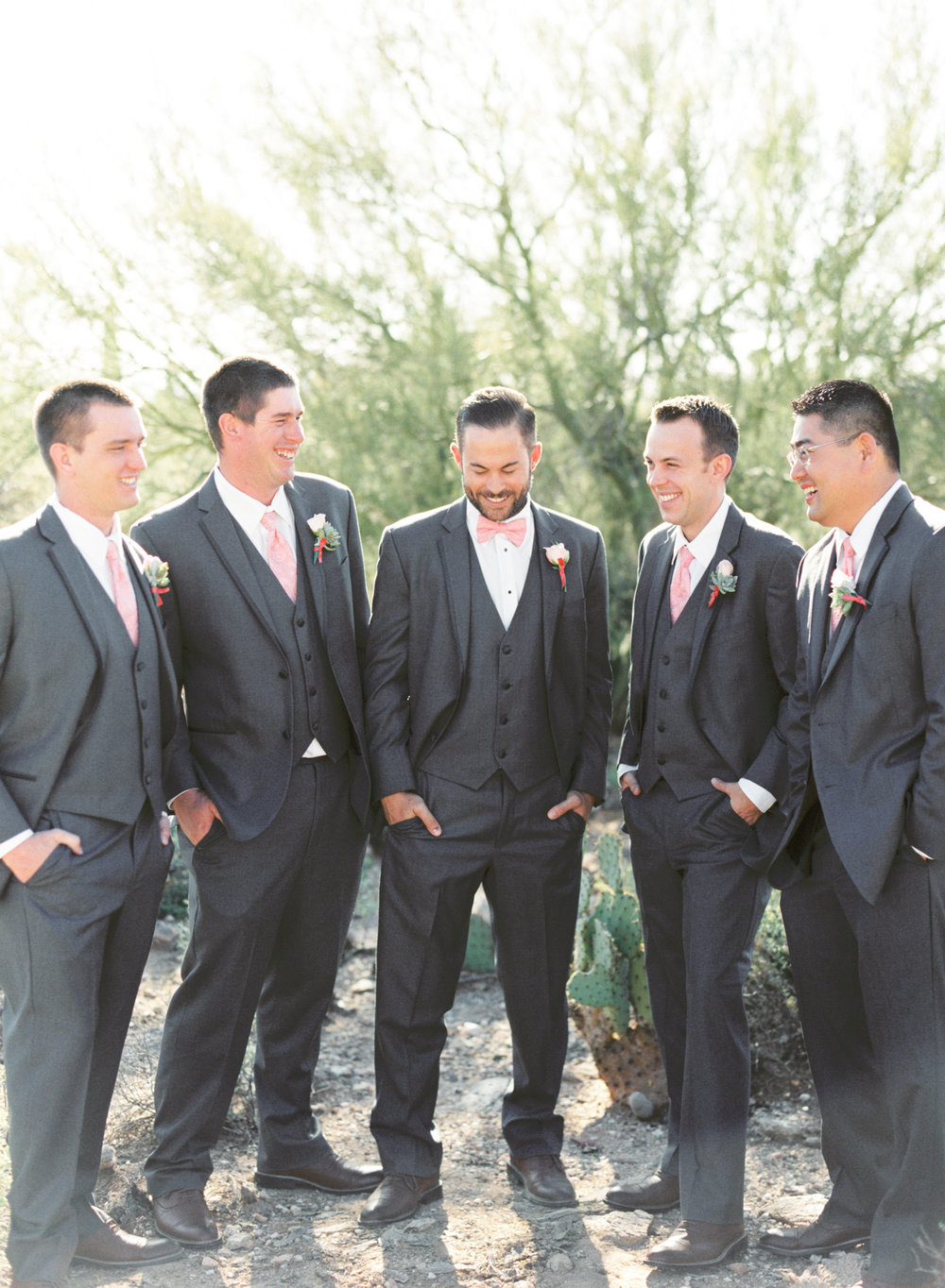 Groomsmen laughing in gray suits