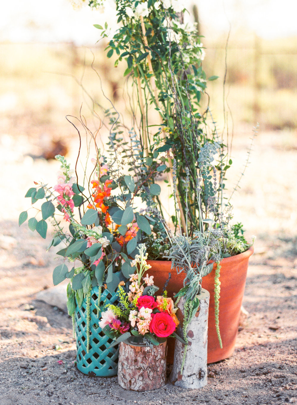 Bright & colorful desert wedding arch with florals by Alexis Grace Florals