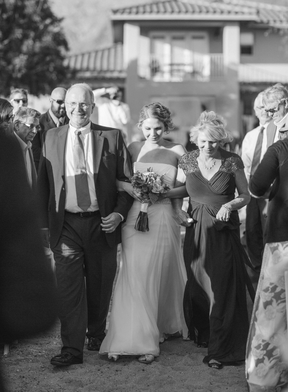Parents walking bride down the aisle