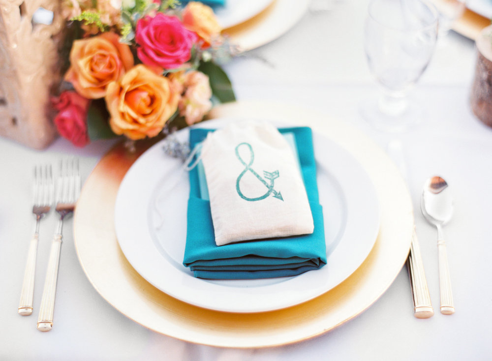 Bright & Colorful Spring Tucson Wedding | Table Setting with florals and smore's favor in bag