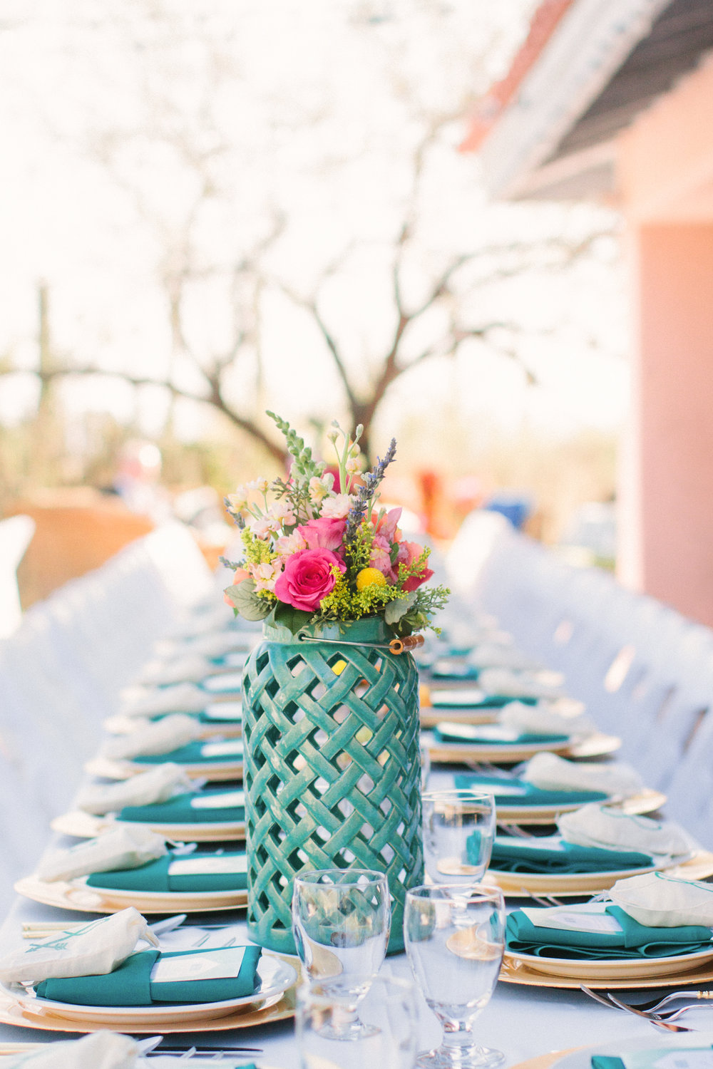 Spring table settings with colorful florals and teal lanterns