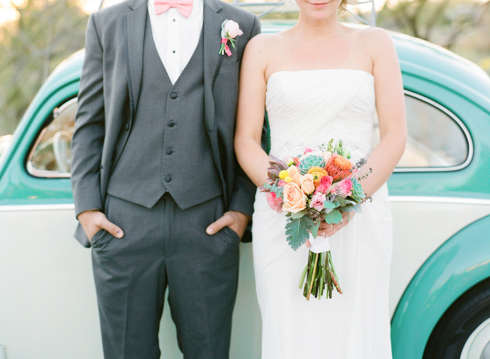 Bride & Groom with teal blue volkswagen beetle getaway car