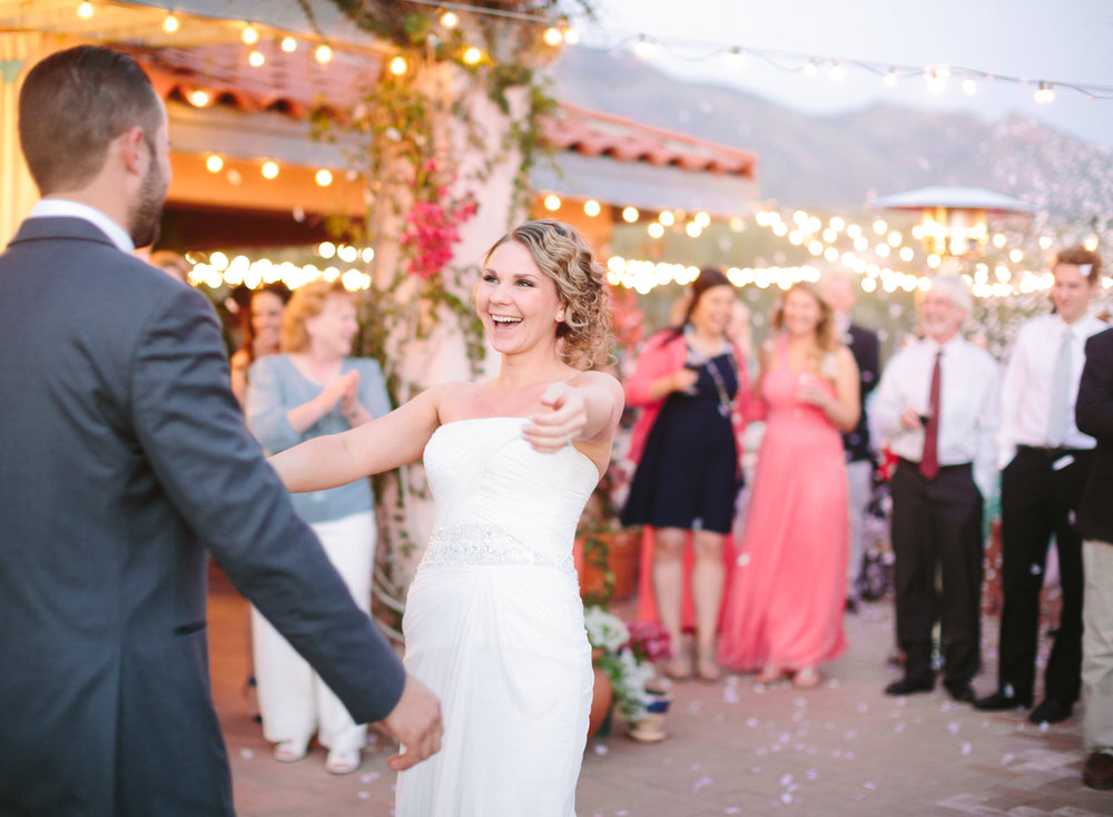 First dance with cafe lights and confetti