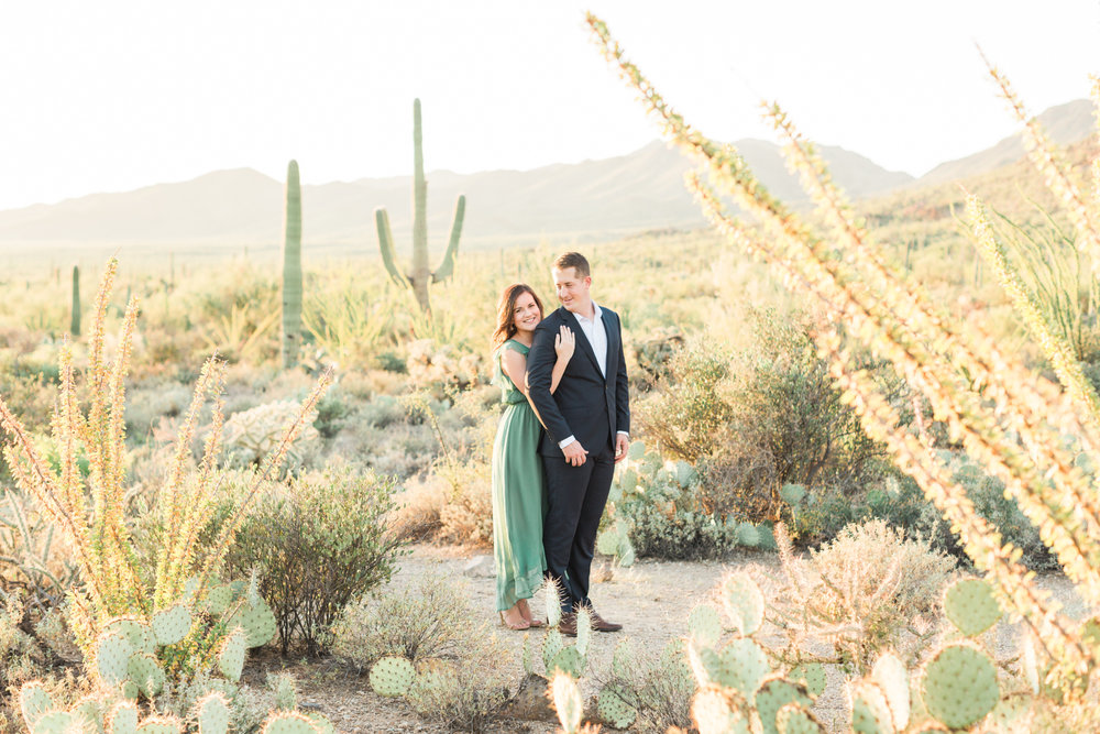 Gorgeous Tucson desert engagement session. Groom adoringly looking at his beautiful bride.