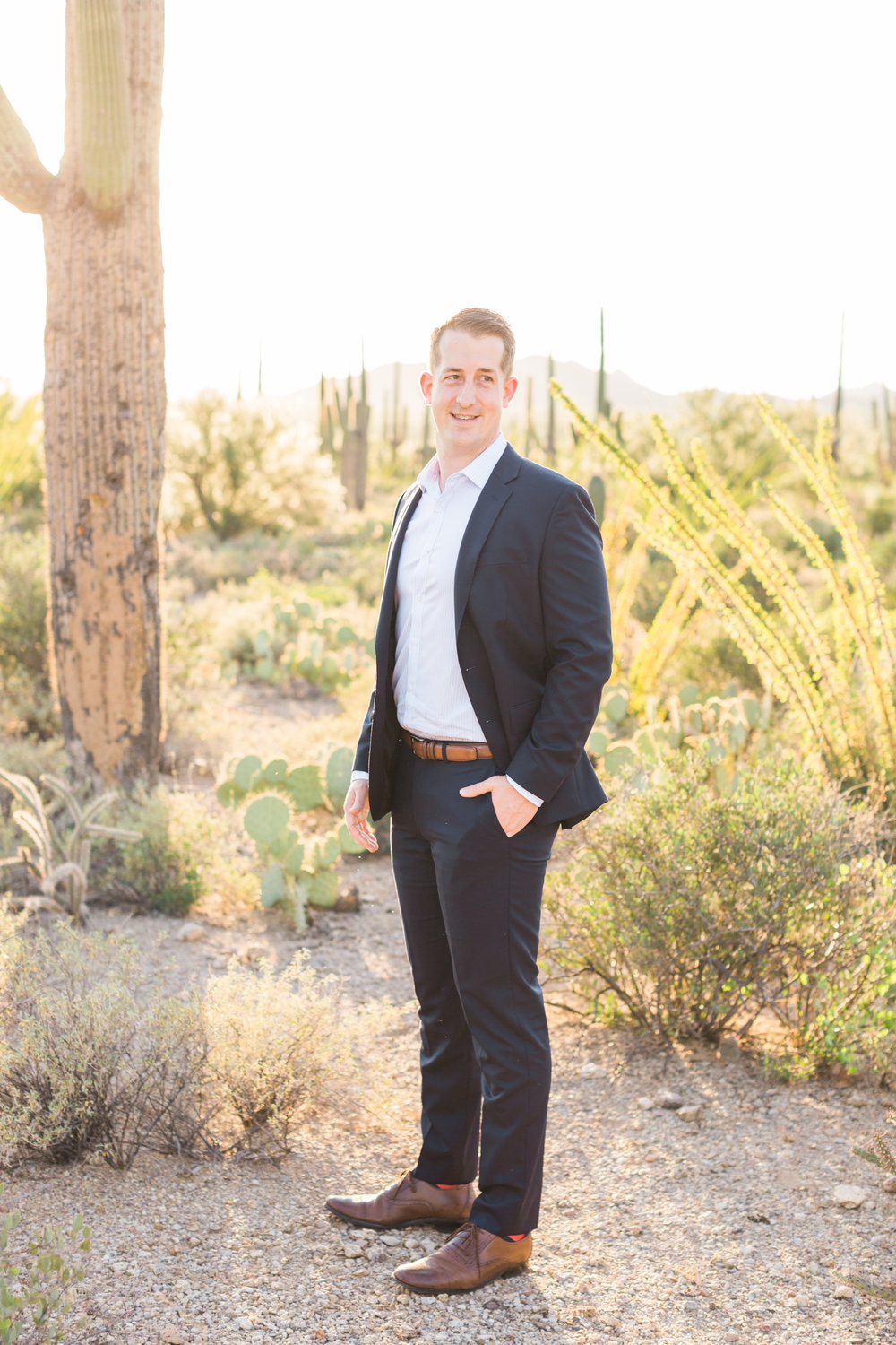 Handsome guy in suit with cactus in the background