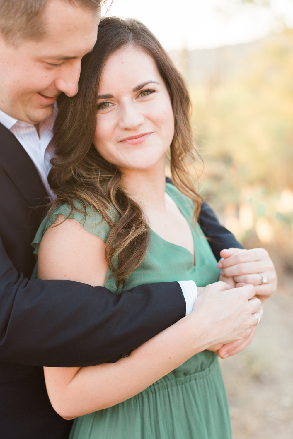 This girl looks so happy to be marrying the man of her dreams. Love the way he's hugging her.