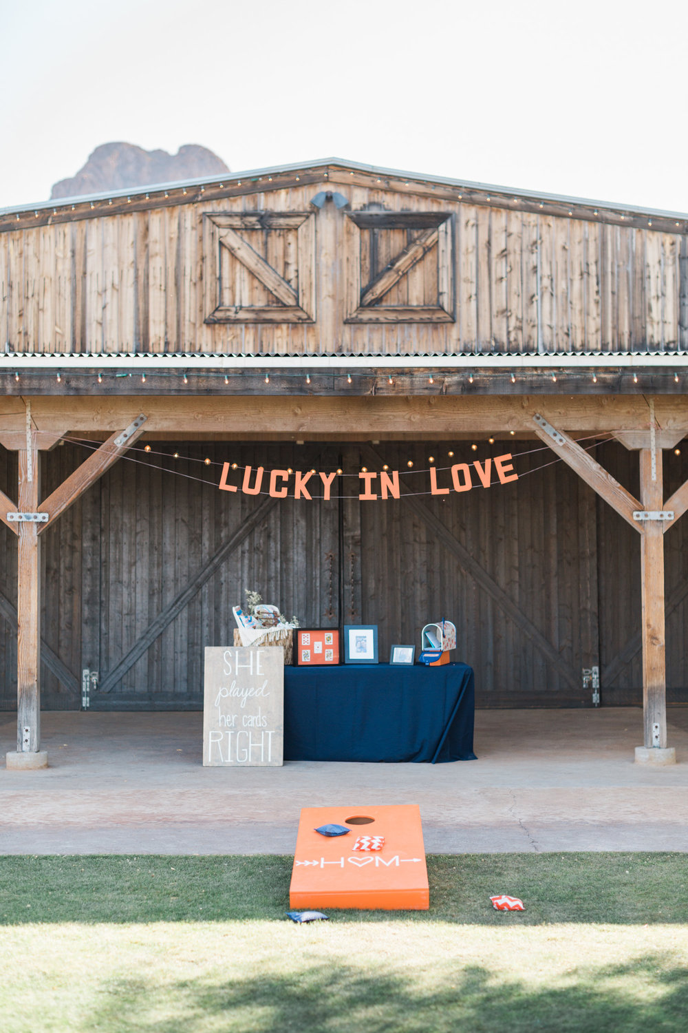 Tucson barn wedding venue, Stardance, all set up for the cocktail hour, complete with custom cornhole game!
