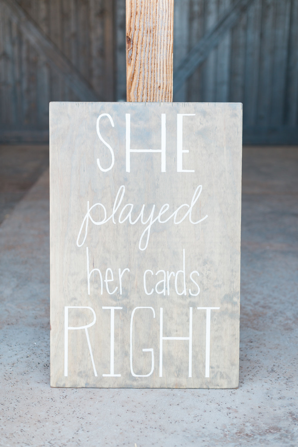Handwritten signs on weathered wood all over this wedding! Love it!