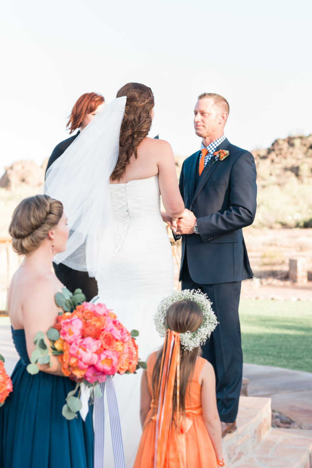 Bride and groom saying their vows to each other at their Tucson, Stardance wedding.