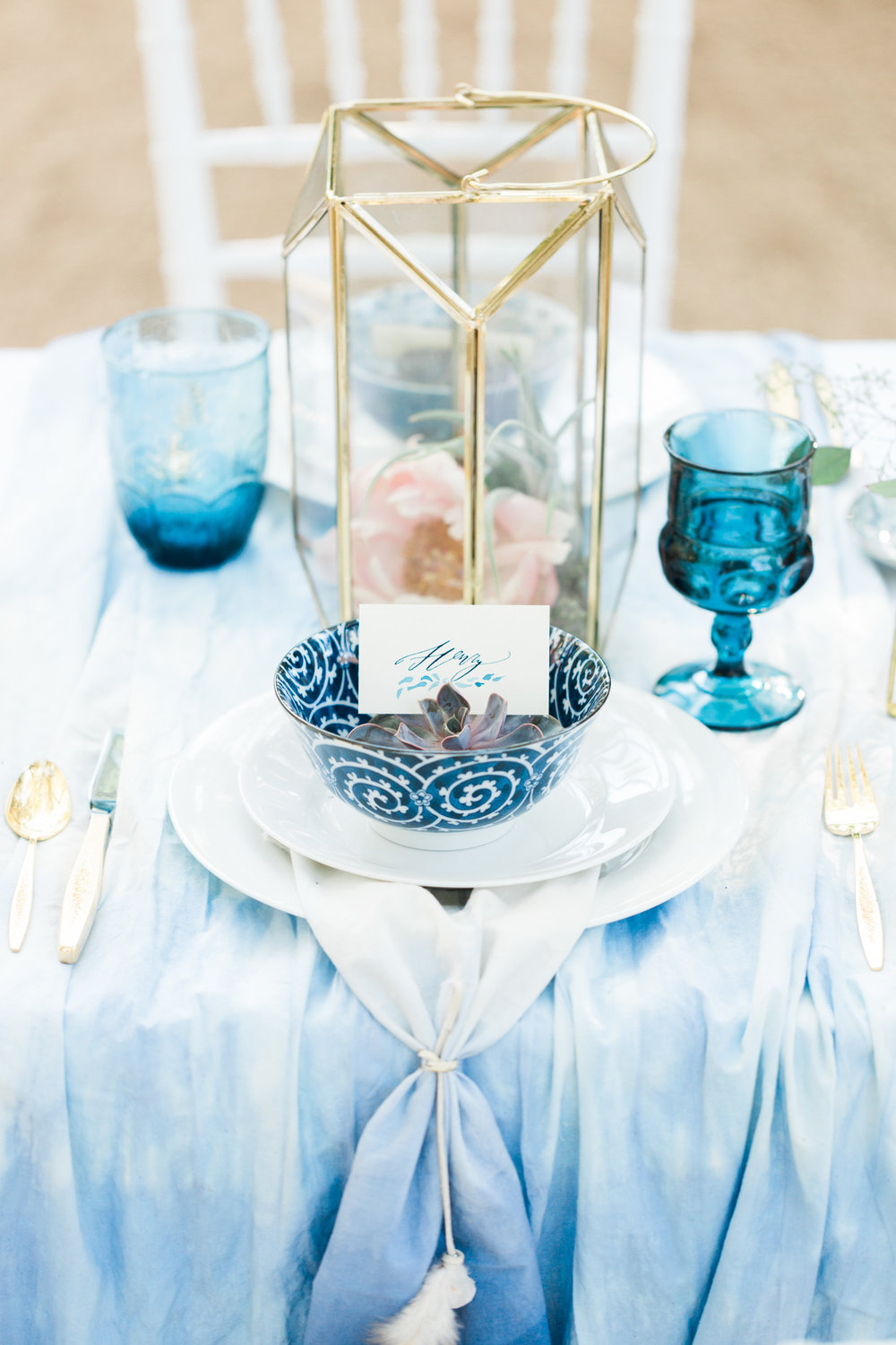 Bohemian indigo table setting with accents of gold and succulent placecard holders with calligraphy by Betsy Dunlap