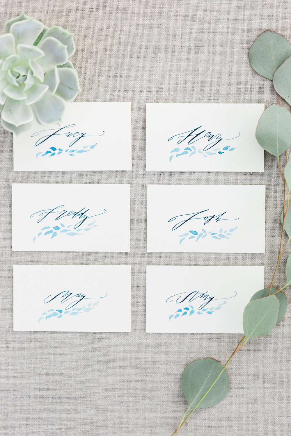 Beautiful place cards by Betsy Dunlap with indigo ink and leaf motifs