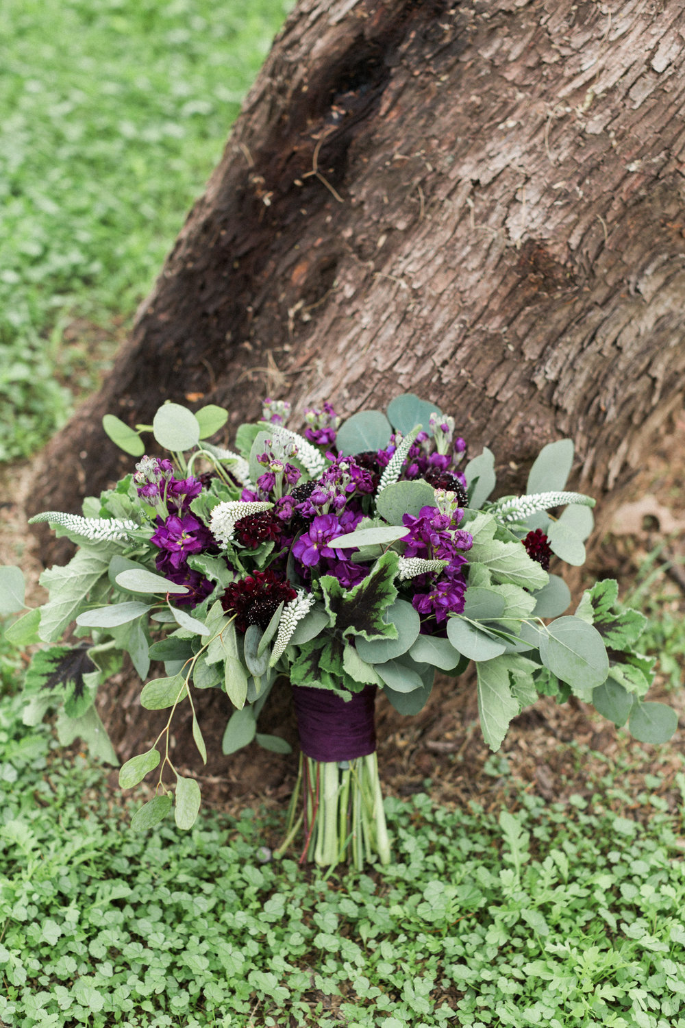 Gorgeous, romantic purple and burgundy bouquet filled with greenery by the talented Butterfly Petals!