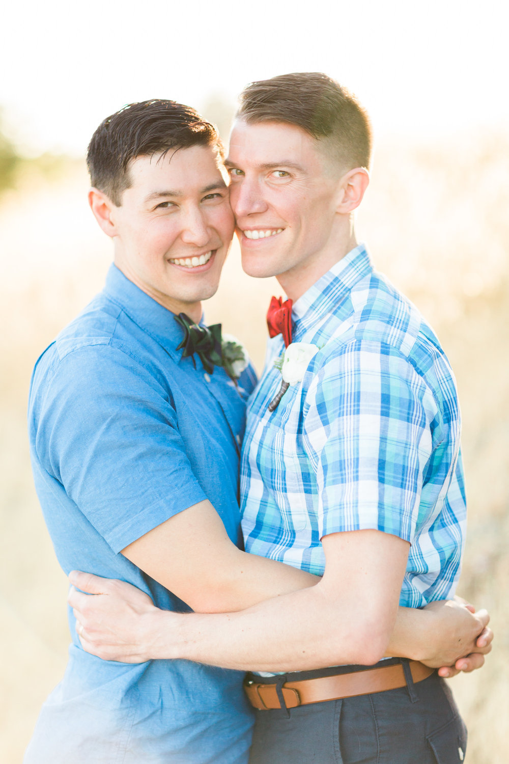 Smiling grooms on their wedding day