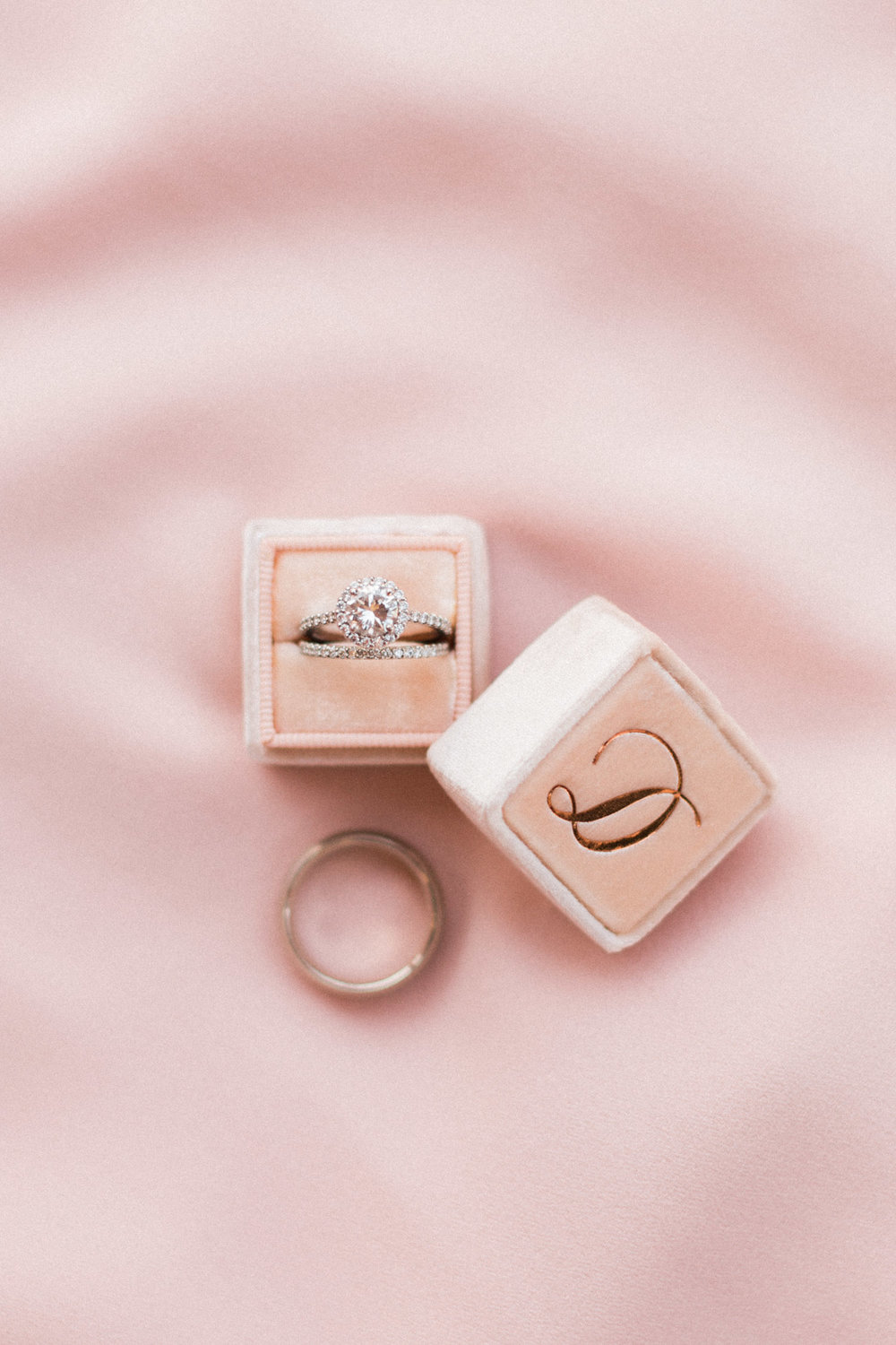 Stunning halo ring with a blush Mrs. Box and copper foil monogram