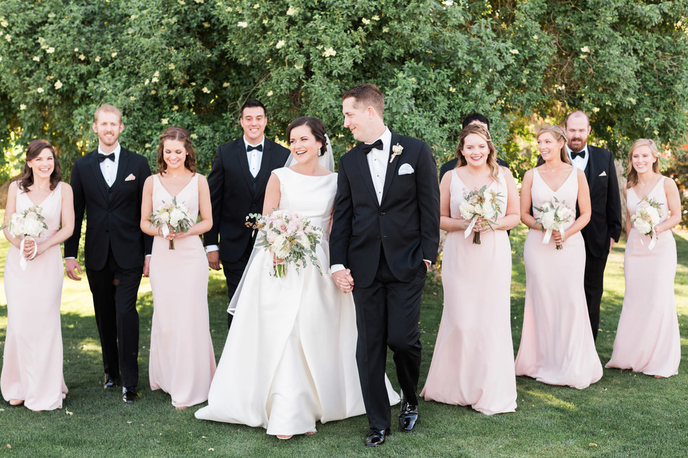Gorgeous Tubac Golf Resort wedding. Wedding party in black tuxedos and blush dresses.