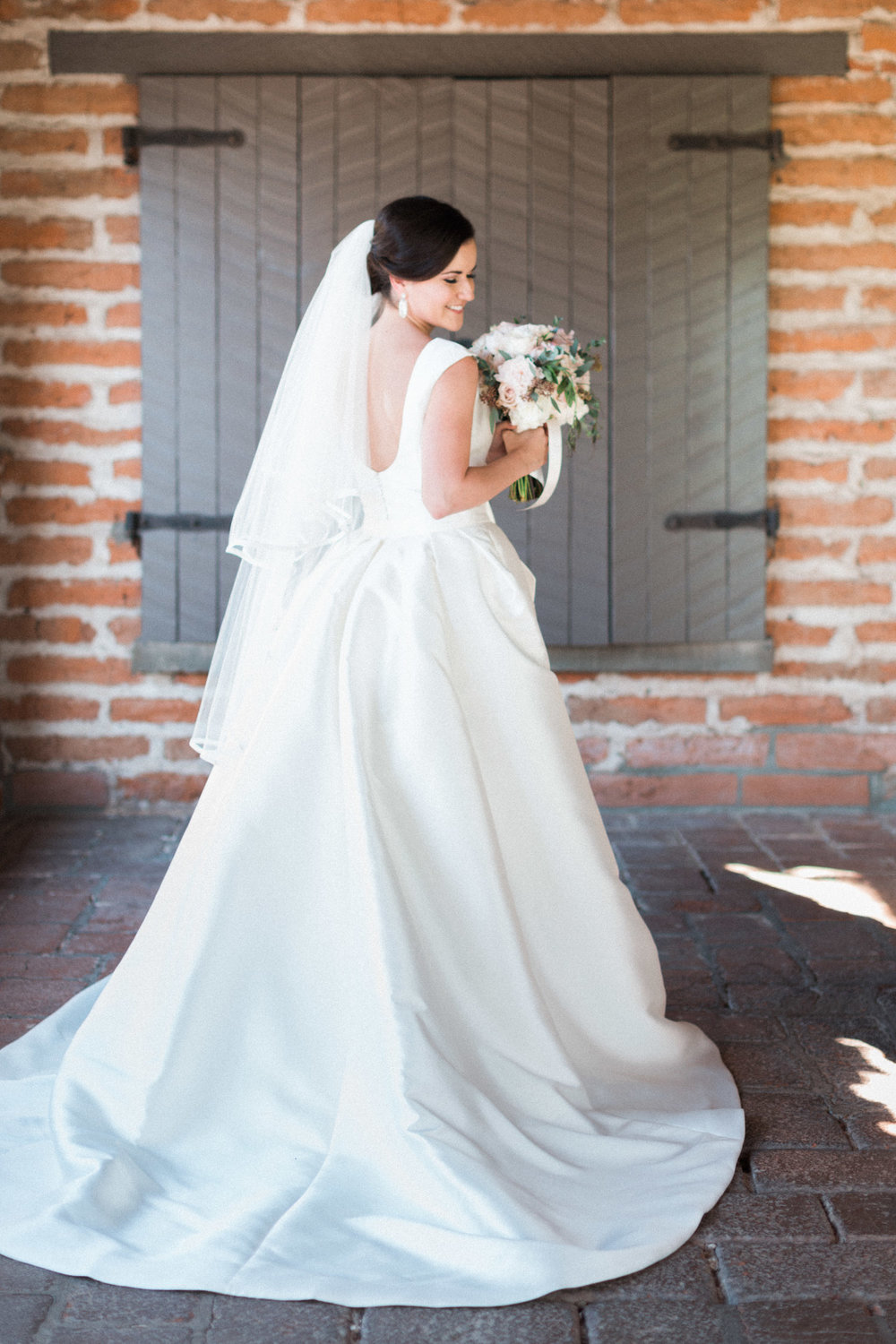 Stunning bride at Tubac golf Resort wedding in convertable Pronovias gown from Gigi Bridal