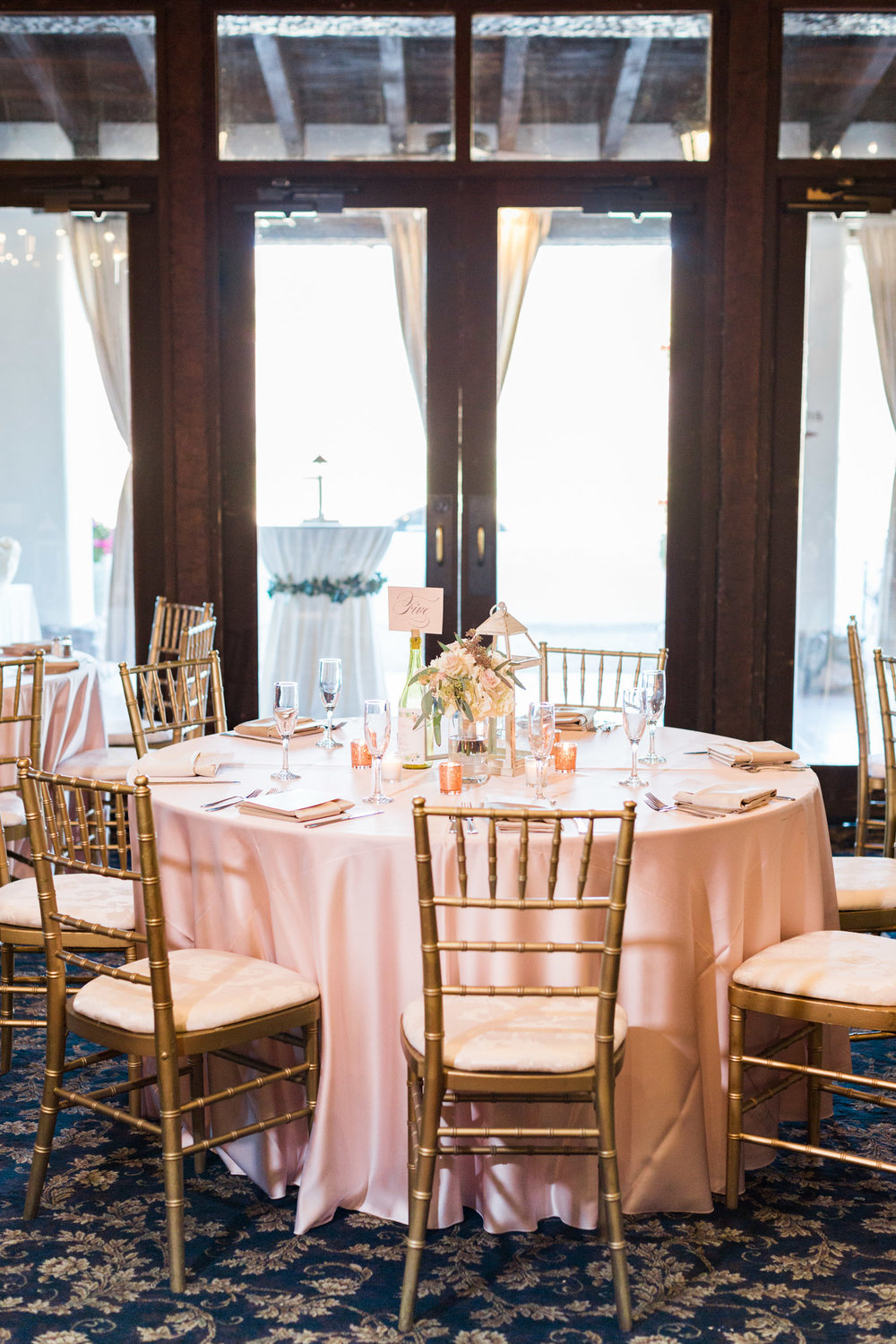 Ballroom set up with blush and gold chiavari chairs