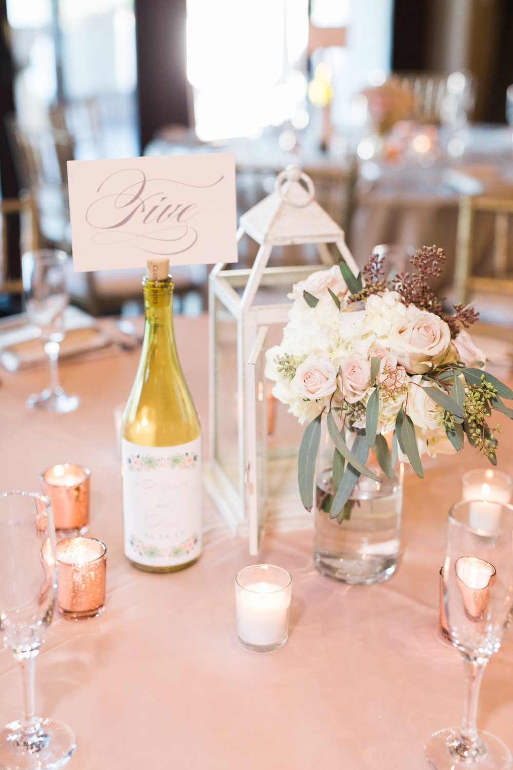 Beautiful florals by Posh Petals and table numbers by Brie Dumais Designs
