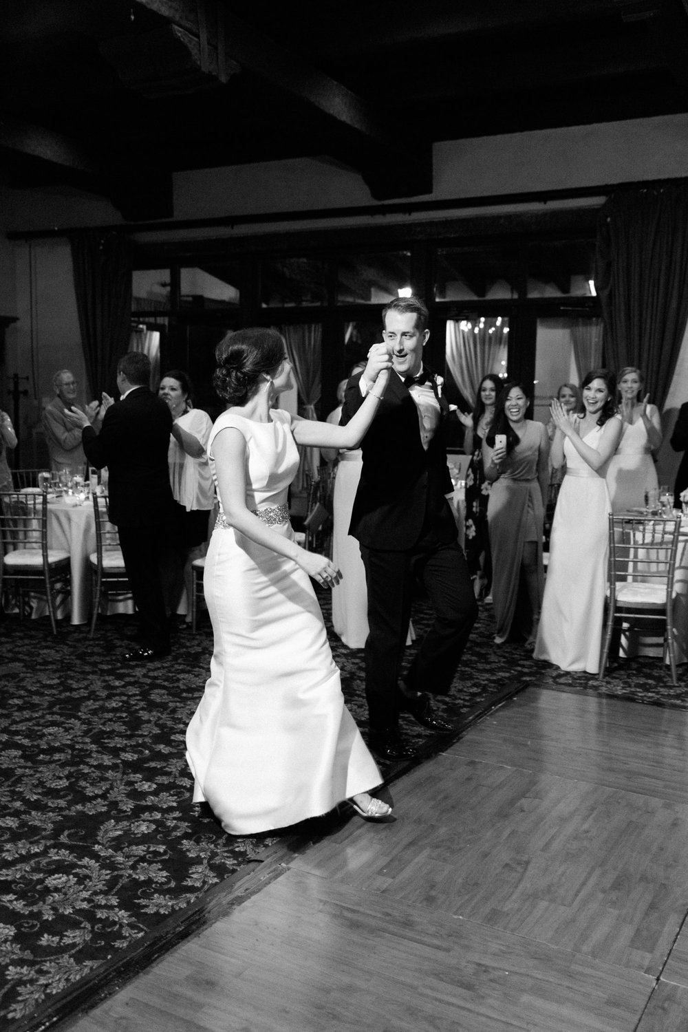 Bride and groom walking onto the dance floor for their first dance