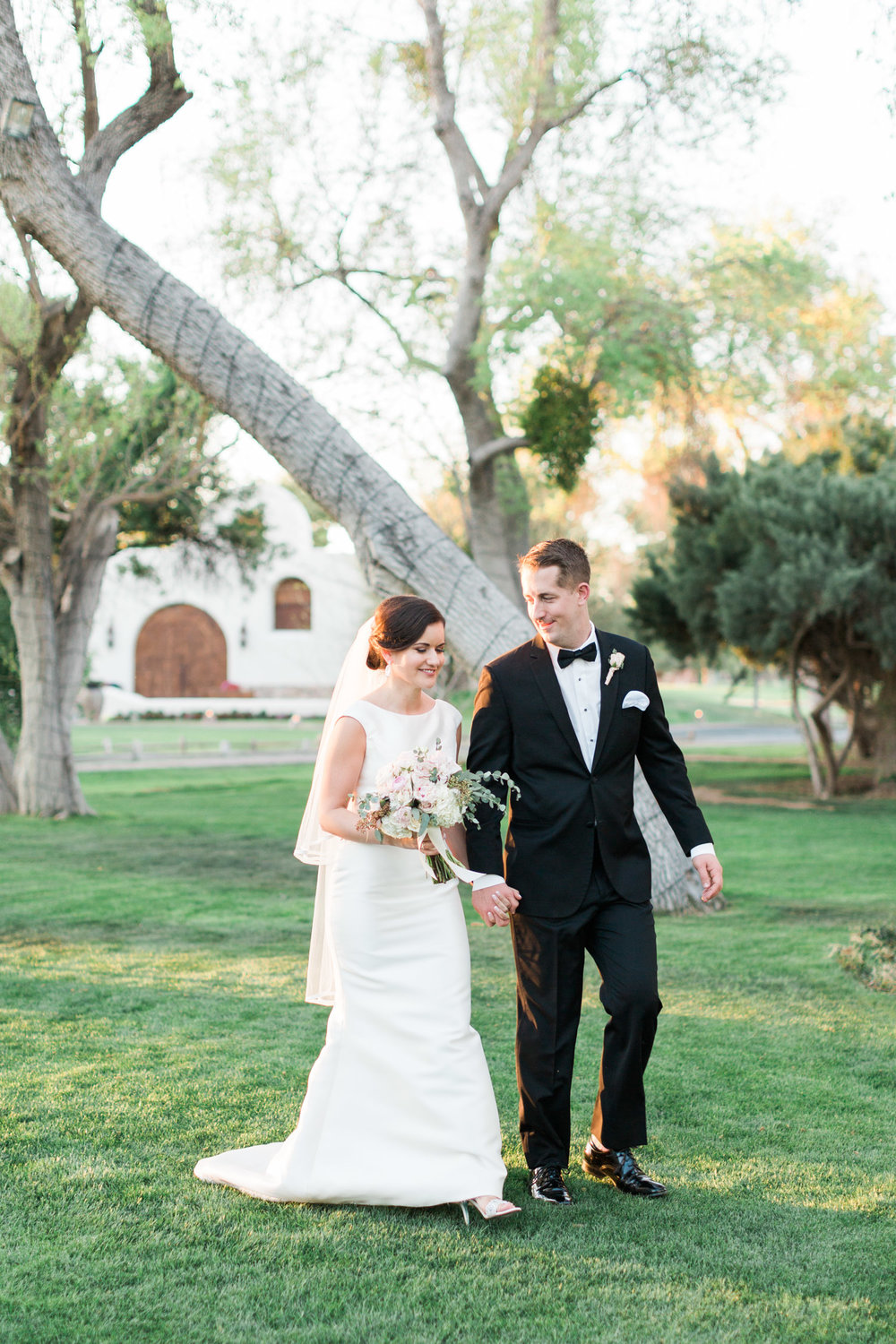 Bride and groom walking during gorgeous golden hour