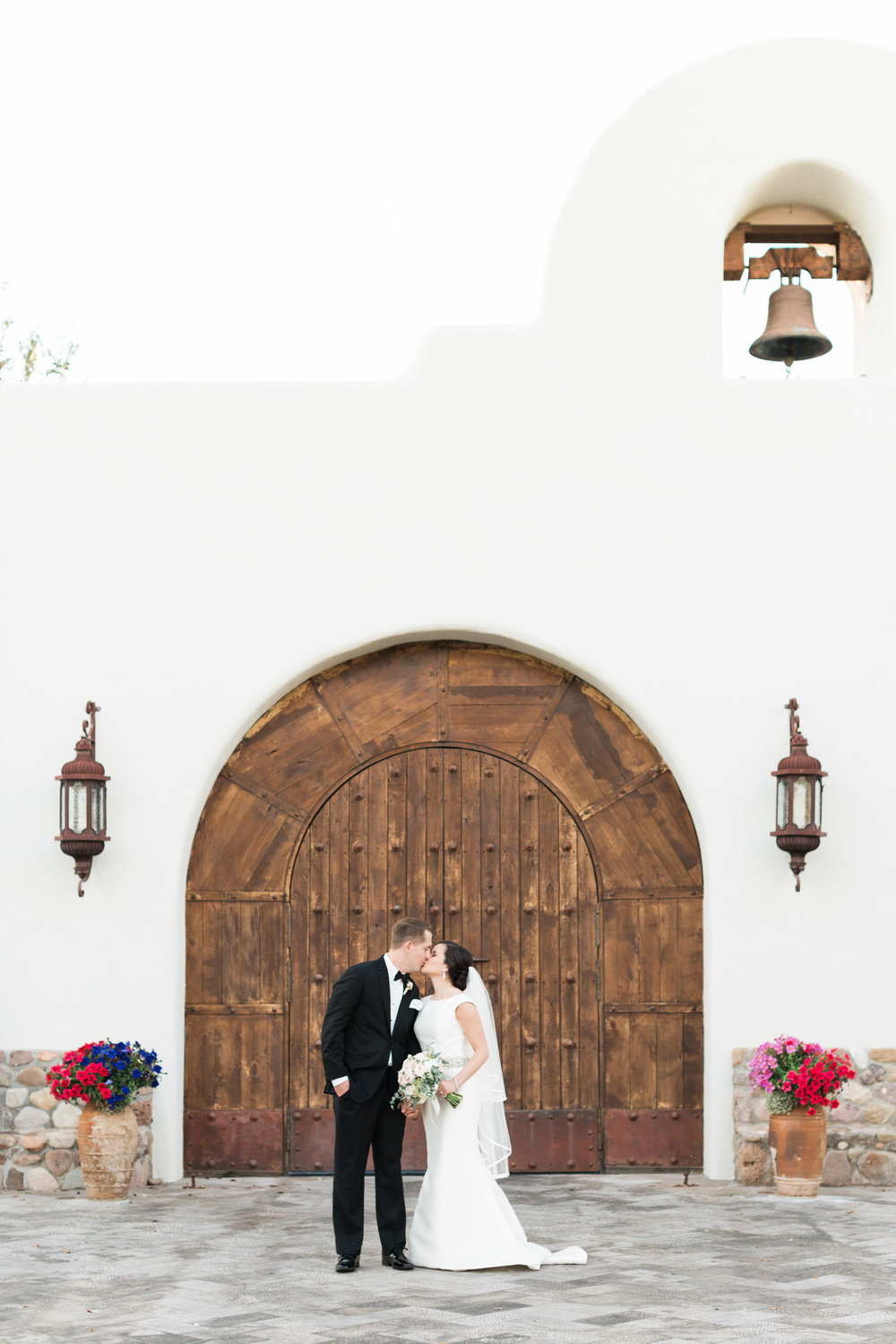 Bride & groom kissing in front of the chapel at Tubac Golf Resort