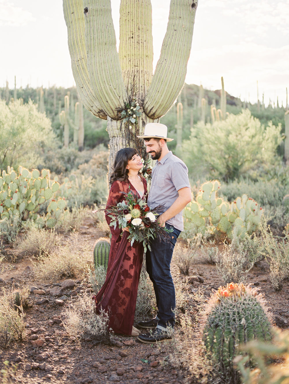 Couple smiling at each other at their desert elopement