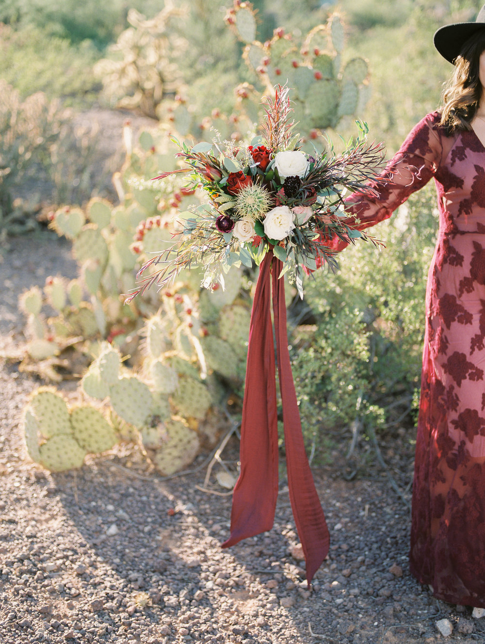 Fall bouquet with burgundy & white roses + cactus & greenery!