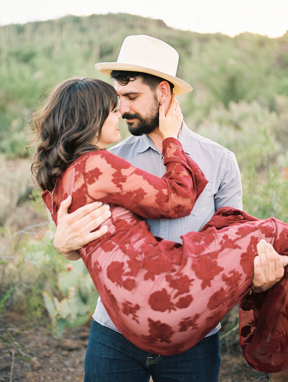 Guy holding girl at their romantic Tucson engagement session