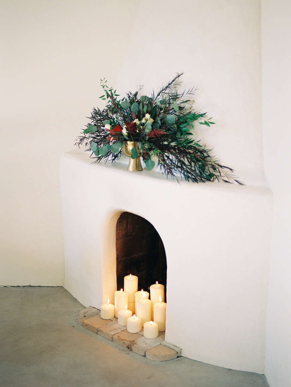 romantic white fireplace with candles burning on Portra 800 film