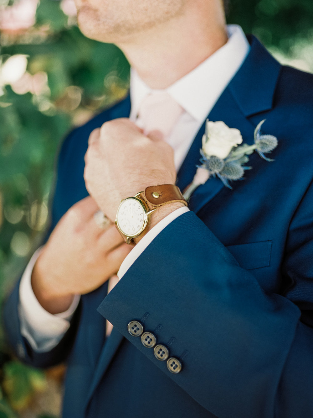 Groom straigtening tie | Harrison & Jocelyne's beautiful Temecula wedding captured by Temecula Wedding Photographers Betsy & John | Temecula film photographers portra 800